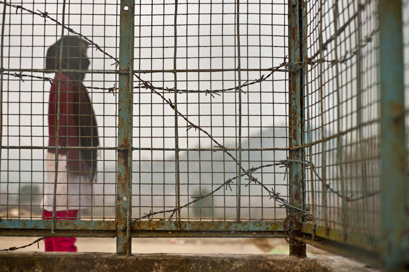 girl with barbed wire; pink boots
