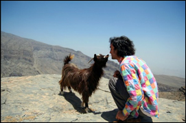 goat with doritos, summit of jabal shems, oman