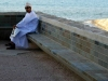 man by the water, muscat