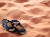 sandals; scorching sand. serving their use.