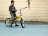 omani boy with bicycle