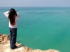 girl with horizon; sky and water meet