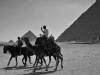 men on camels admiring the volcano activity of egypt and its precise geometric attributes